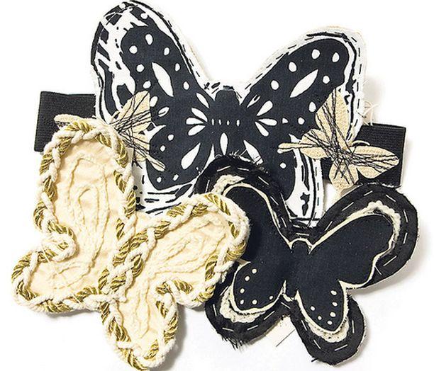ASUSTA RINTAMERKEILLÄ Jos neula ei viuhu omissa kätösissä, voi turvautua apuun. Kaksi vuotta vanha takki saa uuden ilmeen kun hihaan tai rintaan kiinnittää kirjaillun perhosrintamerkin.