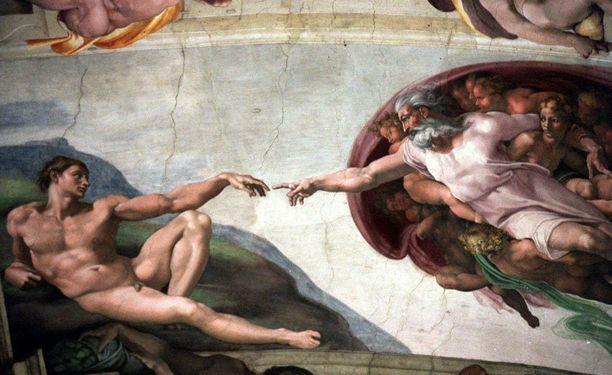 """Michelangelon fresko """"Aatamin luominen"""" Vatikaanin Sikstuksen kappelissa kuvaa ensimmäisen ihmisen luomista."""