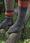 Gallen-Kallelan toisissa sukissa on varressa oranssia vikkelineuletta.