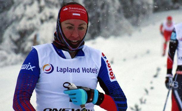 Justyna Kowalczyk oli sukkelin Oloksen sprintissä perjantaina.