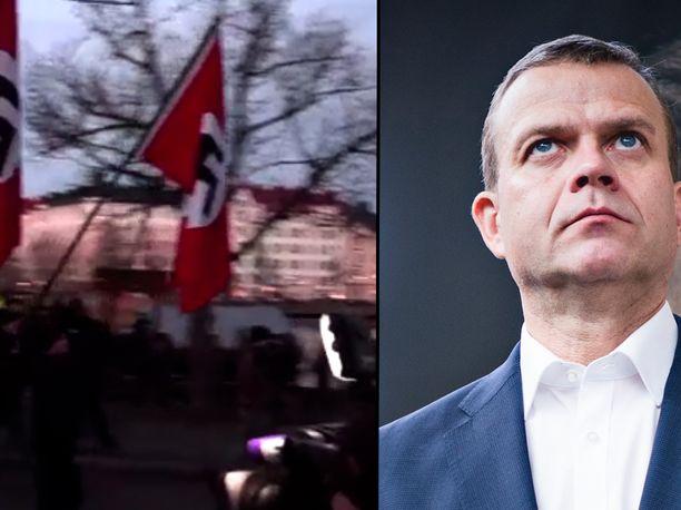 Petteri Orpo otti kantaa natsilippuihin Twitterissä.