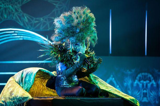 Peacockin vihjeet saavat Masked Singer -panelistit mietteliäiksi.