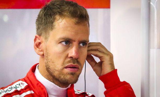 Sebastian Vettel oli onnellinen aika-ajon jälkeen.