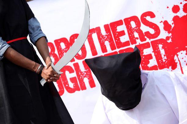 Aktivistit osoittivat Bangladeshissa vuonna 2011 mieltään Saudi-Arabian teloituksia vastaan.
