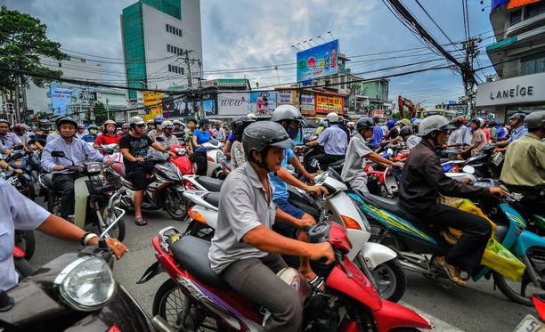 Skootteri on yleinen kulkuväline Kaakkois-Aasian maissa. Kuvassa ihmisiä liikenneruuhkassa Ho Chi Minh Cityssä Vietnamissa.