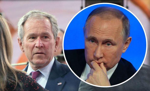 George W. Bushin (vasemmalla) mukaan Venäjän toiminnasta iso osa selittyy sillä, että Venäjän presidentti Vladimir Putin haluaa palauttaa Neuvostoliiton suurvalta-aseman.