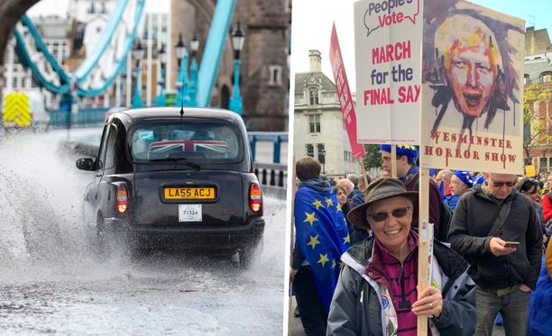 Ellen osoitti mieltään pääministeri Boris Johnsonia esittävän kyltin kanssa Lontoossa. Kuvan taksi ei liity juttuun.