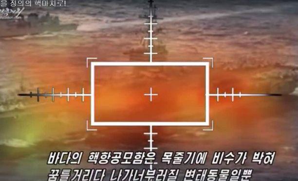 Pohjois-Korea esittää räjäyttävänsä USA:n sotakalustoa propagandavideollaan.