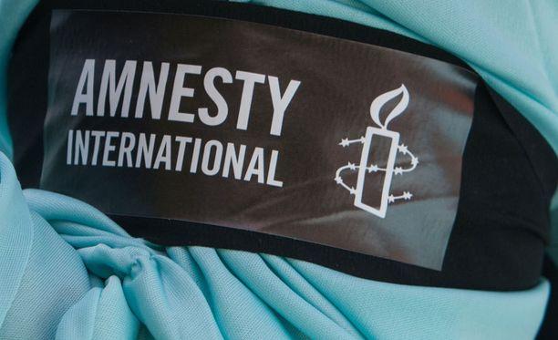Amnesty International pitää sen Turkin johtajan saamaa syytettä tekaistuna.