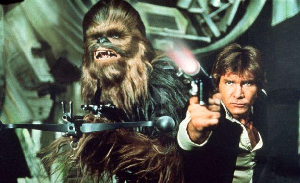 Chewbacca ja Harrison Fordin esittämä Han Solo tähdittävät jälleen Star Warsia. Kuva alkuperäisestä trilogiasta.