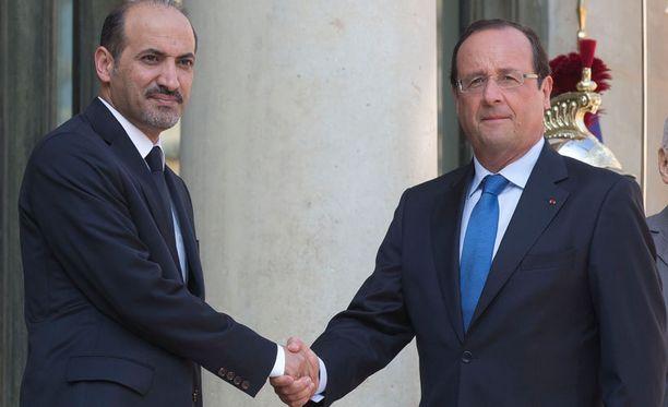 Ranskan presidentti Francois Hollande neuvotteli torstaina Syyrian oppositiojohtaja Ahmend al-Jarban kanssa Pariisissa.