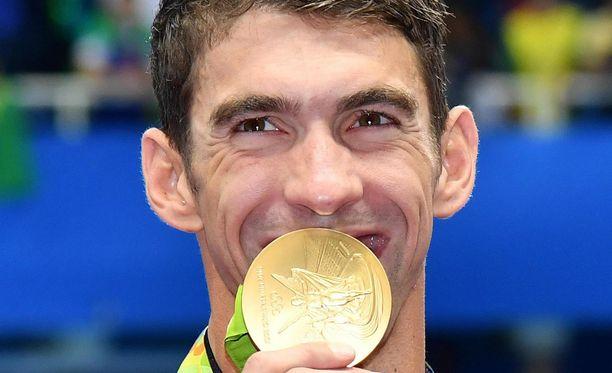 Michael Phelps ja kultamitali kuuluvat yhteen.