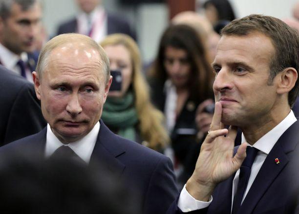 Venäjän presidentti Vladimir Putin tapaa tänään sunnuntaina muun muassa Ranskan presidentti Emmanuel Macronin. Kuva toukokuulta, jolloin Macron osallistui Pietarin kansainväliseen talousfoorumiin.