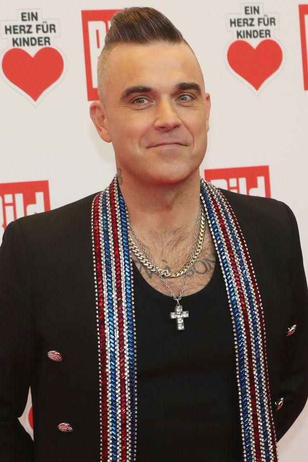 Robbie Williams omistaa nykyään puhelimen.