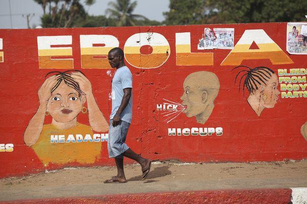 Länsi-Afrikassa tietoisuutta ebolasta levitetään esimerkiksi muraalein. Kuva Liberian pääkaupunki Monroviasta.