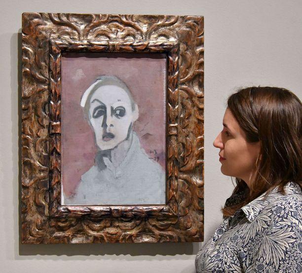 Helene Schjerfbeckin omakuva vuodelta 1939. Brittikriitikko Jonathan Jonesin mukaan taiteilijan viimeiset omakuvat ovat pikemminkin omituisia kuin traagisia.