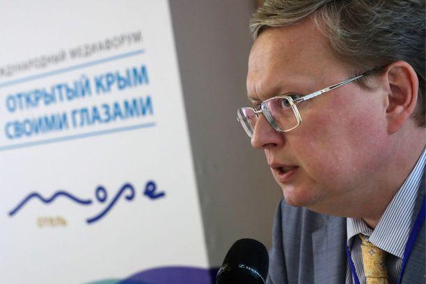 Mihail Deljaginia on sanottu Venäjän presidentti Vladimir Putinin läheiseksi neuvonantajaksi, mutta Deljagin kieltää asian olevan näin. Kuva Open Crimea -tilaisuudesta viime kesältä.