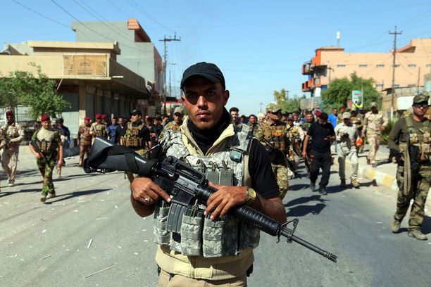 Irakilaisen Hashd al-Shaabi -militian jäsen Kirkukissa lokakuussa sen jälkeen, kun militiaryhmä valtasi alueen. Alueen paikallisväestö on syyttänyt militiaryhmää väkivaltaisuuksista.