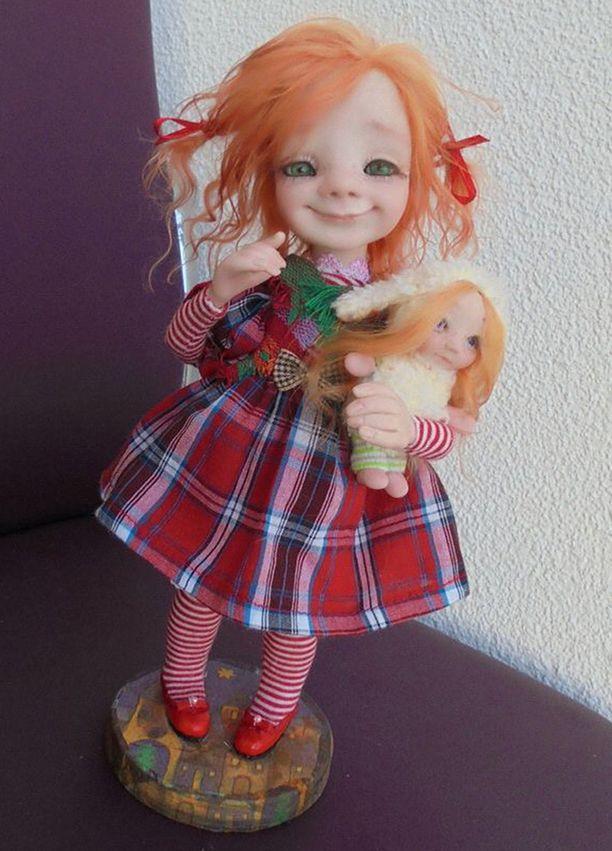 Tällaisia herttaisia nukkeja Medjantseva teki.