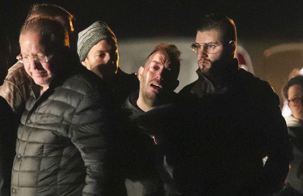 Giuseppe Giordano (keskellä) menetti miltei koko perheensä.