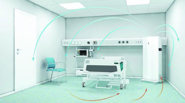 Kuvassa oikealla suomalaisen Genanon ilmanpuhdistin sairaalan eristyshuoneessa.