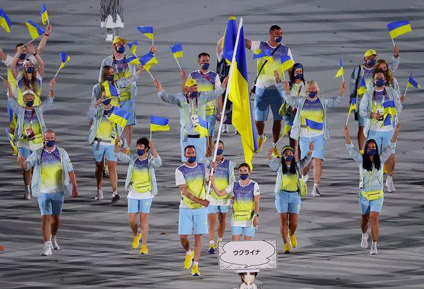 Ukrainan olympiajoukkueen yhteydessä näytettiin kuva Tshernobylistä.