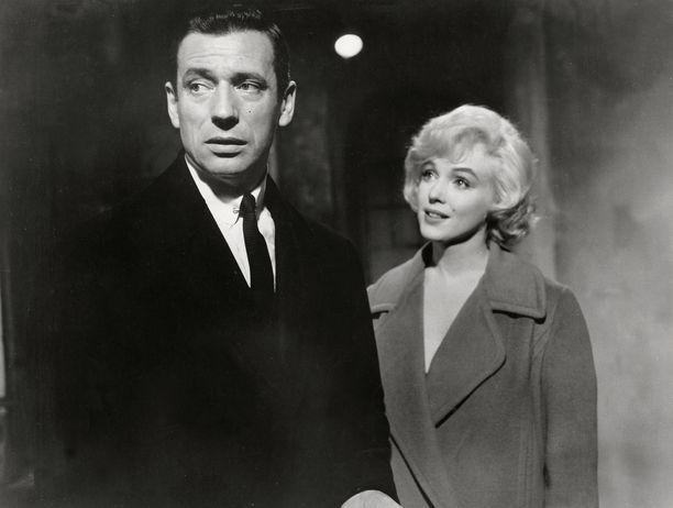 Yves Montand ja Marilyn Monroe elokuvassa Haluan vaimoni takaisin.