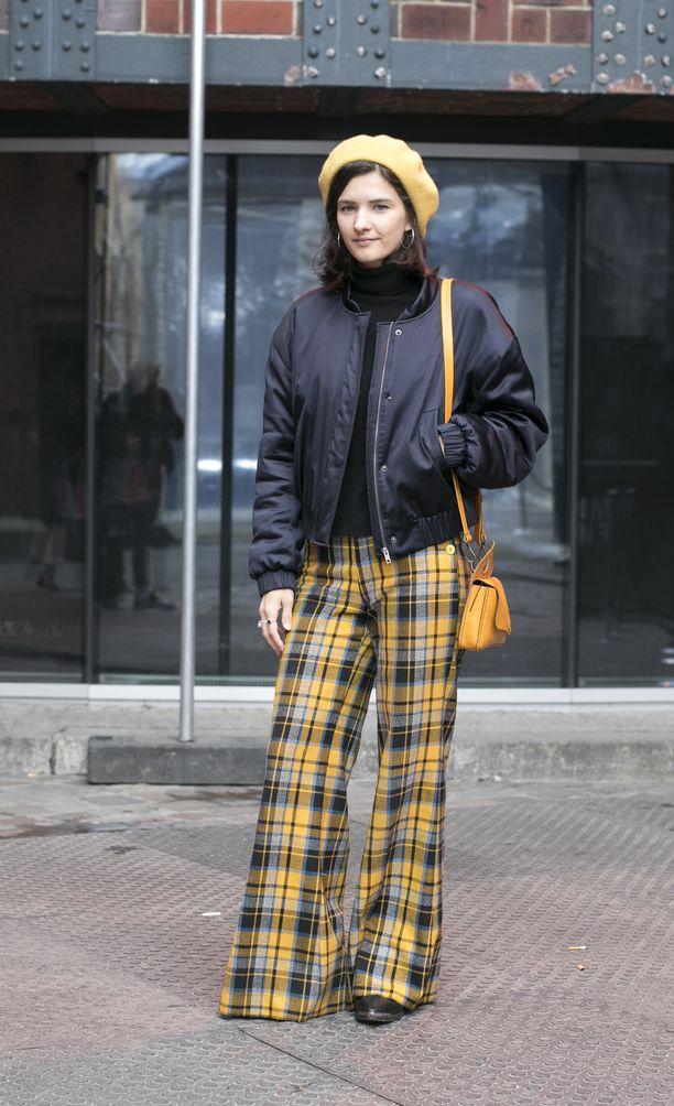 Myös Berliinin muotiviikolla nähtiin paljon ruutua. Leveälahkeiset housut taikovat sääristä superpitkät, pilottitakki sekä baskeri tekevät tyylistä modernin.