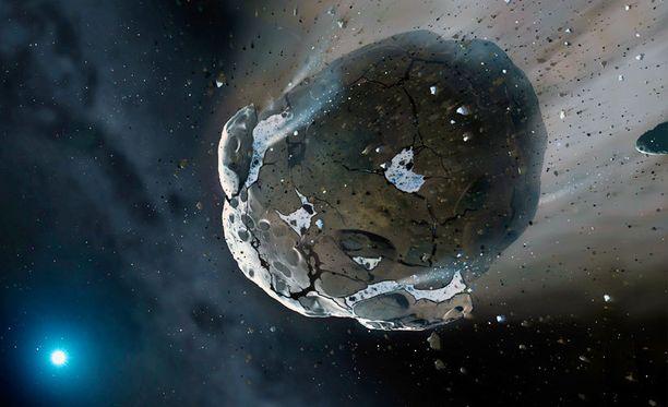 Taiteilijan näkemys hajoavasta asteroidista avaruudessa.
