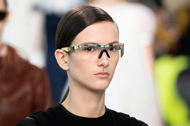 Model on the catwalk, glasses detail