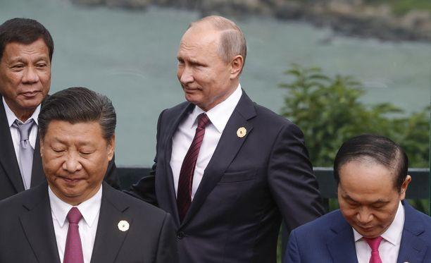 Putin kuvattuna APEC-kokouksen päätöspaivänä lauantaina 11.11.Vietnamissa.