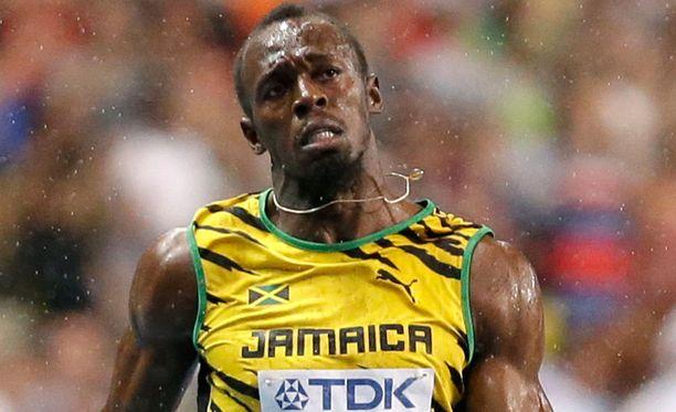 Usain Bolt ei antanut kurjien olosuhteiden hidastaa itseään liialti.