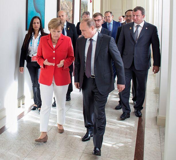 The Independent -lehti kirjoitti torstaina Saksan ja Venäjän työstäneen salassa suunnitelmaa Ukrainan tilanteen rauhoittamiseksi. Kuva Brasiliasta jalkapallon MM-kisoista heinäkuun puolivälistä.