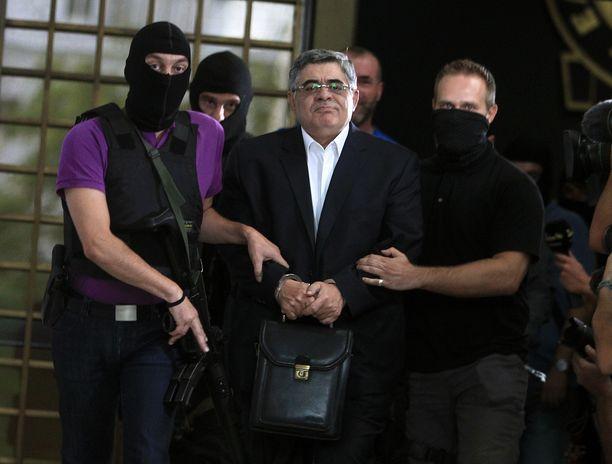 Nikos Michaloliakos joutuu 13 vuodeksi vankilaan. Arkistokuva.