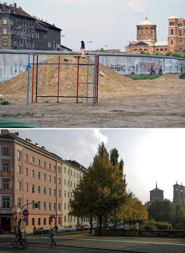 Lapsi leikki muuri edustalla sen länsipuolella Kreuzbergissa vuonna. Sittemmin muuri on kadonnut ja asuinrakennukset restauroitu.
