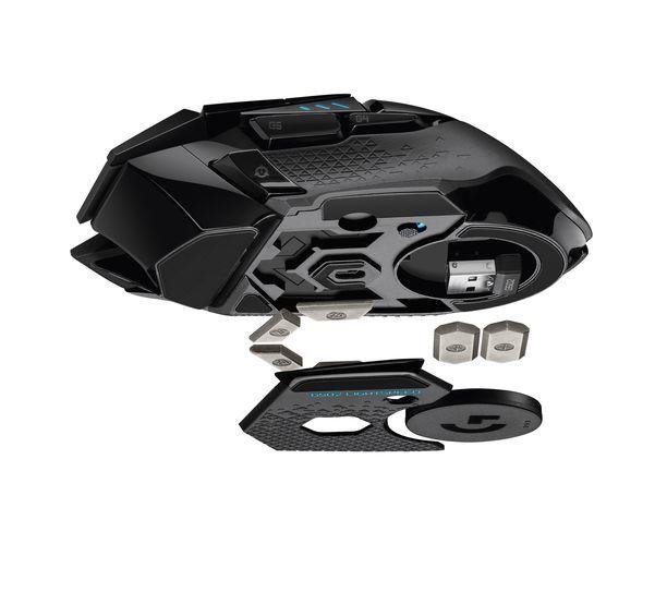 Vastaanotin kulkee hiiren sisällä. Painoja voi lisätä niille varattuihin paikkoihin.