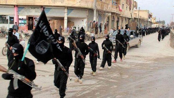 Tammikuussa 2014 propagandasivustolla julkaistu kuva Isisin militanteista Raqqassa.