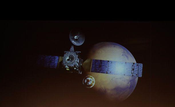 Havainnekuva Marsia lähestyvästä Schiaparelli-laskeutujasta.