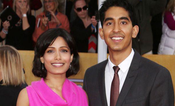 Freida Pinto ja Dev Patel vuonna 2013.