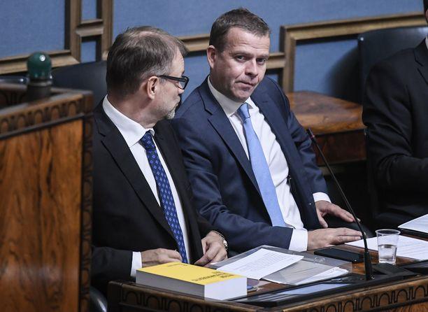 Juha Sipilä (kuvassa vas.) ja Petteri Orpo.
