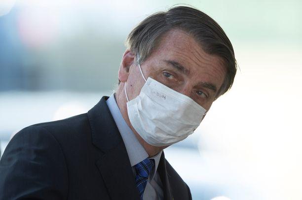 Brasilian presidentti Jair Bolsonaro on nähty maski kasvoillaan vain harvoin.
